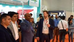 Photo: Exhibitors and visitors at the retail trade fair in-store asia in India; copyright: Messe Düsseldorf